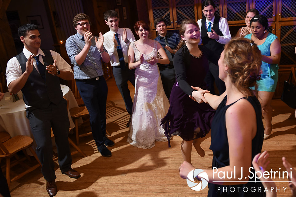Guests dance during Ellen and Jeremy's May 2016 wedding reception at Bittersweet Farm in Westport, Massachusetts.