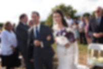 Beth walks down the aisle during her August 2018 wedding ceremony at Fort Phoenix in Fairhaven, Massachusetts.