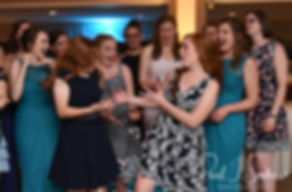 Guests try to catch the bouquet during Brian & Sarah's June 2018 wedding ceremony at the College of the Holy Cross in Worcester, Massachusetts.