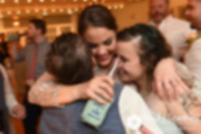 Arielle hugs friends during her September 2017 wedding reception at North Beach Club House in Narragansett, Rhode Island.