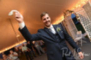Ethan gets ready to toss the garter during his August 2018 wedding reception at a private residence in Sterling, Connecticut.