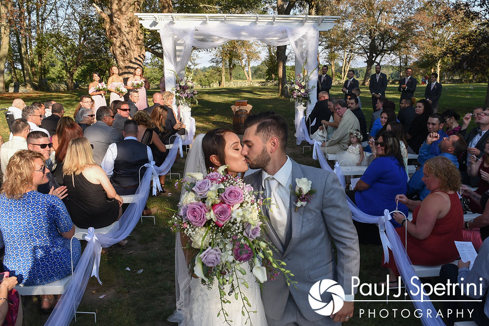 Stacey and John kiss at the end of the aisle during their September 2017 wedding ceremony at Colt State Park in Bristol, Rhode Island.