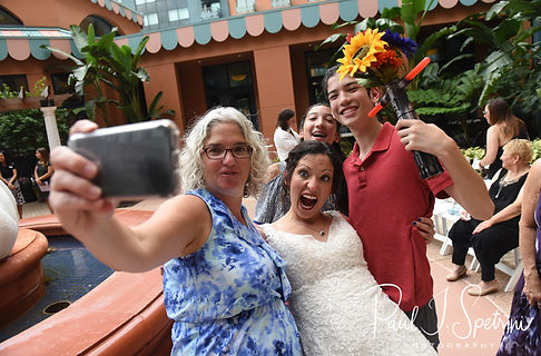 Amanda poses for a photo with family members following her October 2018 wedding ceremony at the Walt Disney World Swan & Dolphin Resort in Lake Buena Vista, Florida.