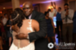 Kemi and her dad share a hug during her August 2016 wedding reception at the Villa at Riddler Country Club in East Bridgewater, Massachusetts.