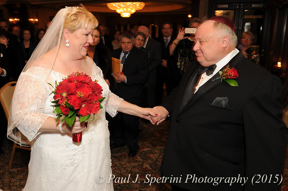 Cathy and Ron embrace during their December 2015 wedding at Quidnessett Country Club in North Kingstown, Rhode Island.