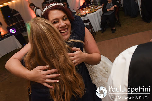 Brooke hugs a guest during her October 2016 wedding reception at The Farm at SummitWynds in Jefferson, Massachusetts.