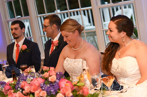 Laura and Marijke smile as Marijke's maid of honor gives a toast during their June 2018 wedding reception at Independence Harbor in Assonet, Massachusetts.