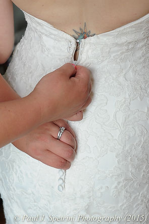 Jamie Bolani has her wedding dress zipped up before her June 2015 wedding in Portsmouth, Rhode Island.