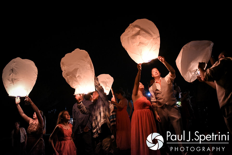 Guests release Chinese lanterns during Michelle and Eric's May 2016 wedding at Hillside Country Club in Rehoboth, Massachusetts.