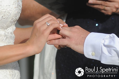 Sean and Cassie exchange wedding rings during their July 2017 wedding ceremony at Rachel's Lakeside in Dartmouth, Massachusetts.