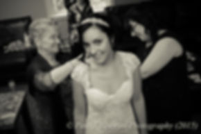 Emma received help putting her dress on prior to her November 2015 wedding at the Publick House in Sturbridge, Massachusetts.
