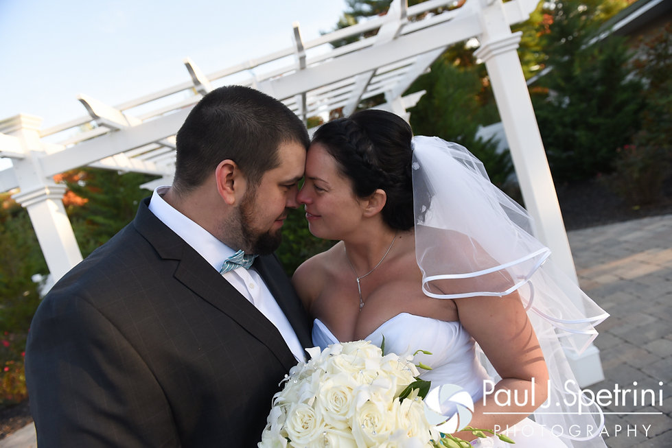 Kelly and Brian pose for a formal photo following their November 2016 wedding ceremony at the Bay Pointe Club in Buzzards Bay, Massachusetts.