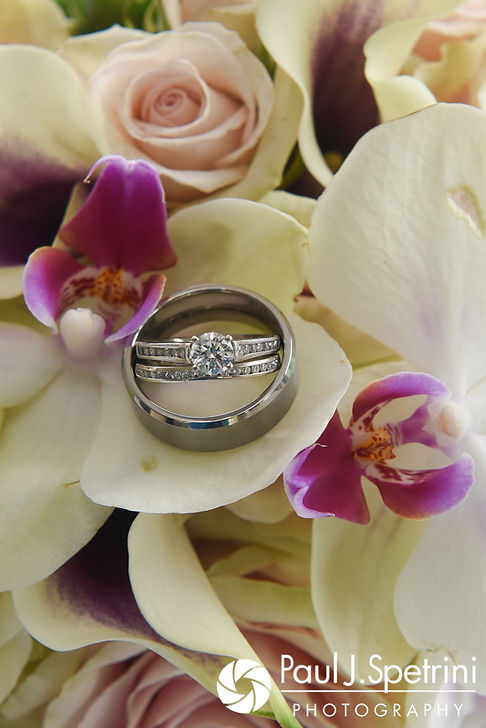 A look at Jeffrey and Clarissa's wedding ring and flowers, seen during their June 2017 wedding reception at Twelve Acres in Smithfield, Rhode Island.