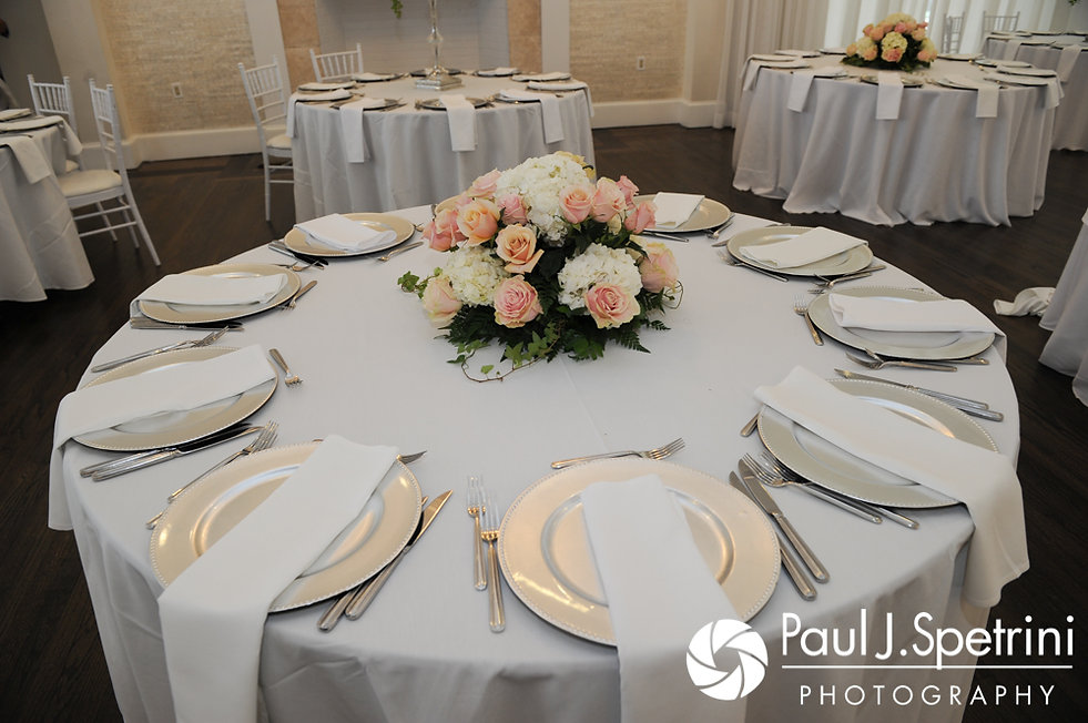 A look at the table settings on display during Nashua and Nader's July 2017 wedding reception at Belle Mer in Newport, Rhode Island.