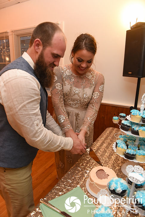 Arielle and Gary cut their wedding cake during their September 2017 wedding reception at North Beach Club House in Narragansett, Rhode Island.