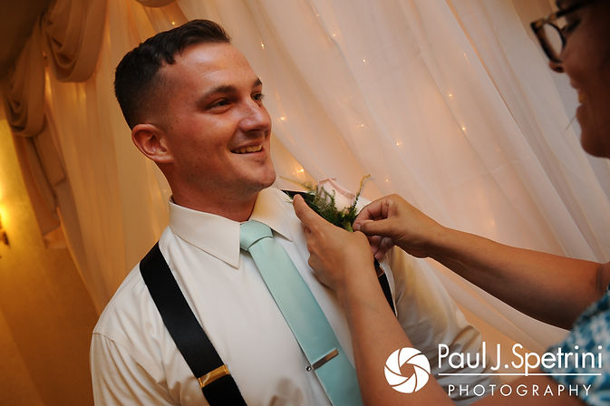 Sean has his flower adjusted prior to his July 2017 wedding ceremony at Rachel's Lakeside in Dartmouth, Massachusetts.