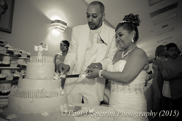 Joe and Jean Andrade cut their wedding cake.