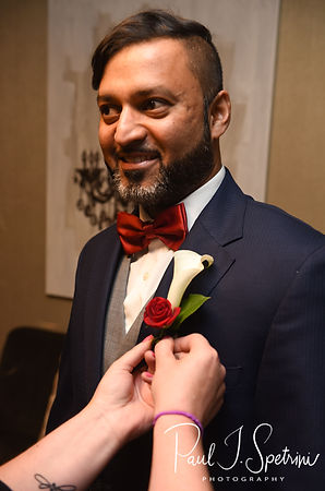 Jimmy has a boutonnière put on prior to his July 2018 wedding ceremony at Lake Pearl in Wrentham, Massachusetts.