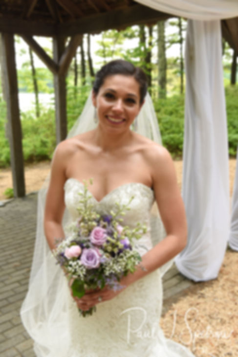 Kendra smiles for a photo following her May 2018 wedding ceremony at Crystal Lake Golf Club in Mapleville, Rhode Island.