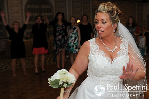 Angela gets ready to throw the bouquet at her spring 2016 Rhode Island wedding at the Hotel Viking in Newport, Rhode Island.