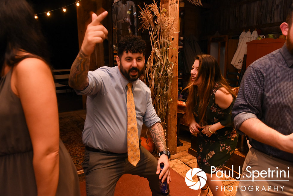 Guests dance during Samantha and Dale's October 2017 wedding reception at the Golden Lamb Buttery in Brooklyn, Connecticut.