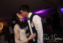 Stacey & Mack kiss during their December 2018 wedding reception at Independence Harbor in Assonet, Massachusetts.