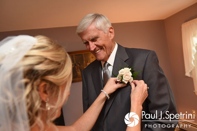 Tricia puts her father's boutonniere on prior to her October 2017 wedding ceremony at St. Brendan Parish in Riverside, Rhode Island.