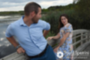 Jessica and Keiran act silly for a photo on a bridge at Ryan Park in North Kingstown, Rhode Island during their August 2017 engagement session.