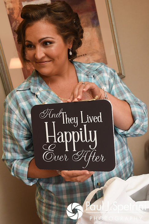 Toni holds up a sign for her ringbearer prior to her August 2017 wedding ceremony at Crystal Lake Golf Club in Mapleville, Rhode Island.