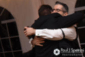 JD hugs his best man following his toast during his October 2016 wedding reception at The Farm at SummitWynds in Jefferson, Massachusetts.