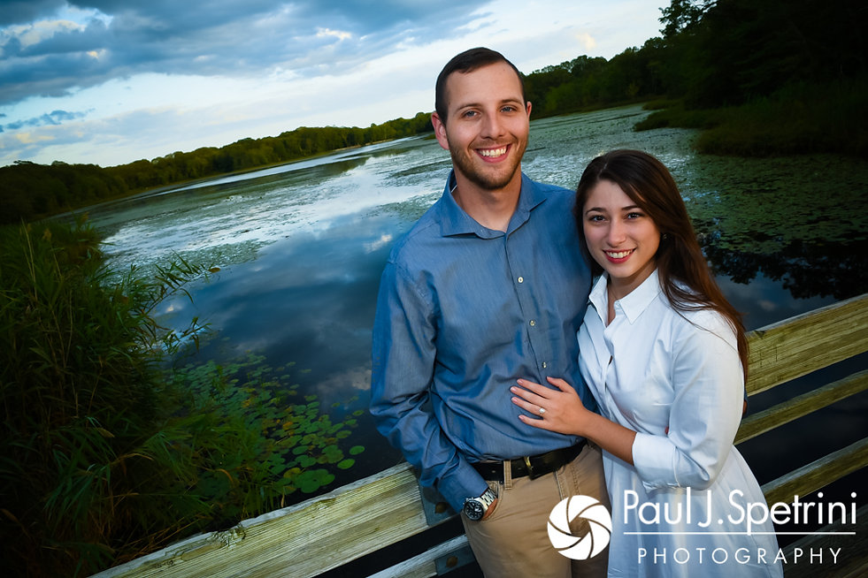 Jessica and Keiran smile for a photo on a bridge at Ryan Park in North Kingstown, Rhode Island during their August 2017 engagement session.