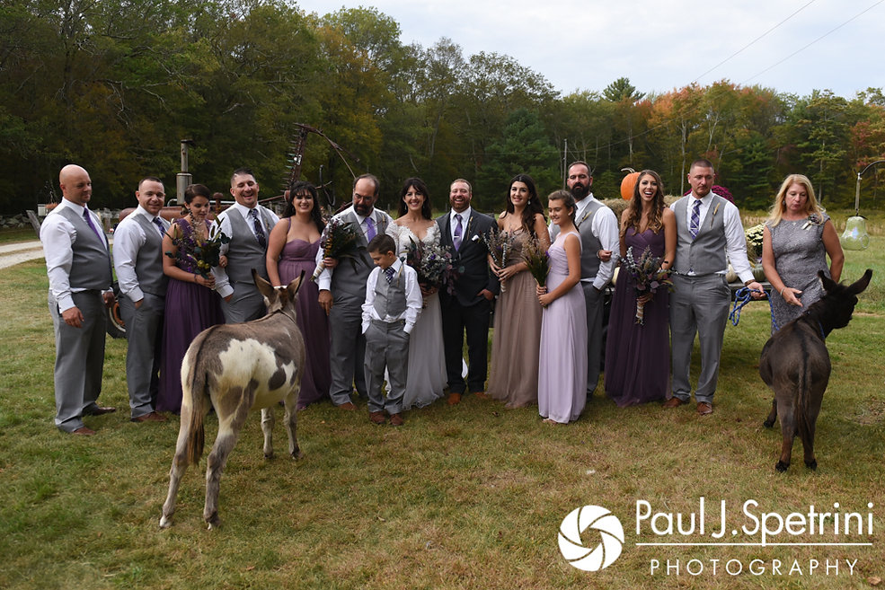 Samantha and Dale pose for a formal photo with their wedding party at their home in Foster, Rhode Island.