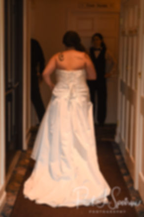 Laura leaves the bridal suite prior to her June 2018 wedding ceremony at Independence Harbor in Assonet, Massachusetts.