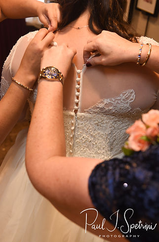 Katie has her dress zipped up prior to her October 2018 wedding ceremony at The Villa at Ridder Country Club in East Bridgewater, Massachusetts.