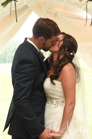 Karolyn and Ethan kiss during their August 2018 wedding ceremony at a private residence in Sterling, Connecticut.