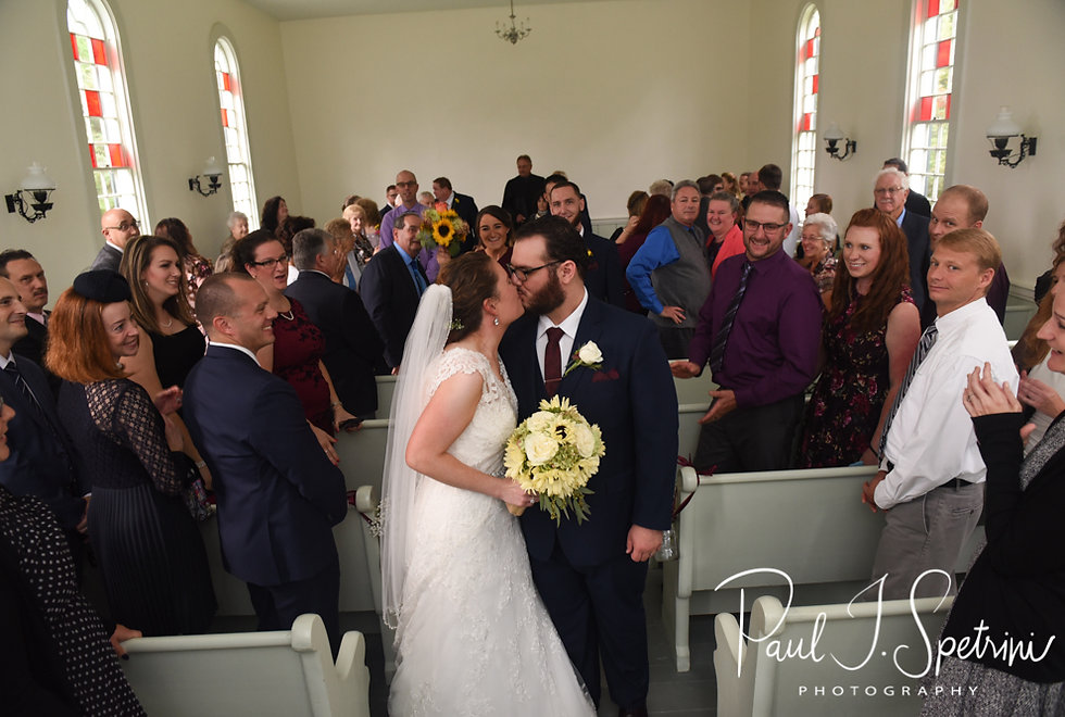 Rob and Allie kiss following their October 2018 wedding ceremony at South Ferry Church in Narragansett, Rhode Island.