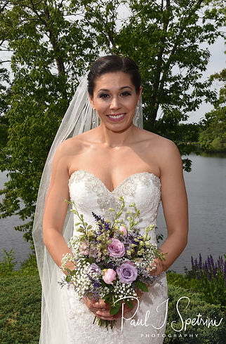 Kendra smiles prior to her May 2018 wedding ceremony at Crystal Lake Golf Club in Mapleville, Rhode Island.