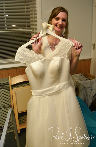 Amber gets ready to change dresses during her June 2018 wedding reception at North Beach Clubhouse in Narragansett, Rhode Island.