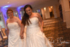 Laura and Marijke enter during their June 2018 wedding reception at Independence Harbor in Assonet, Massachusetts.