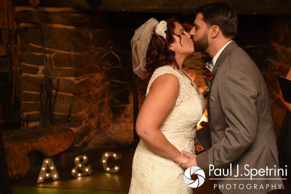 Crystal and Andy share their first kiss during their November 2016 wedding ceremony at the Salem Cross Inn in West Brookfield, Massachusetts.