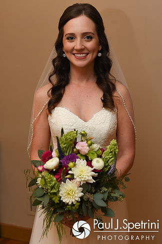 Alyssa smiles for a photo prior to her August 2016 wedding ceremony at Holy Name Church in Fall River, Massachusetts.