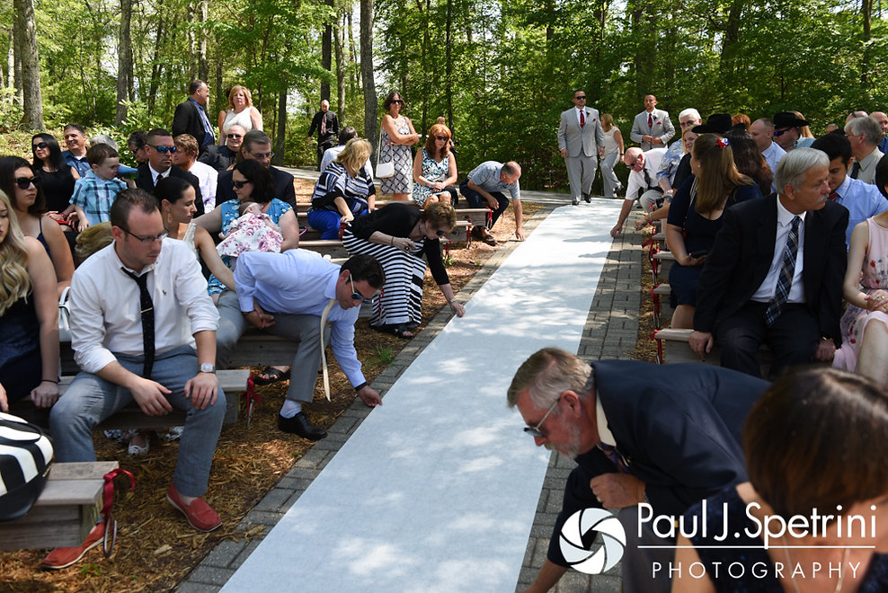 Guests adjust the aisle runner prior to John and Heather's July 2016 wedding ceremony at Crystal Lake Golf Club in Burrillville, Rhode Island.