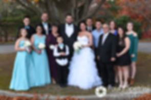 Kelly and Brian pose for a formal photo with family members following their November 2016 wedding ceremony at the Bay Pointe Club in Buzzards Bay, Massachusetts.