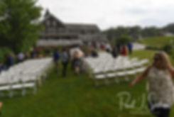 Guests flee as it starts to rain prior to Zach & Kelly's June 2018 wedding ceremony at Blissful Meadows Golf Club in Uxbridge, Massachusetts.