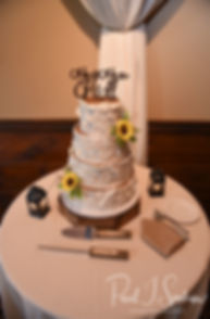 A look at the wedding cake on display during Zach & Kelly's June 2018 wedding reception at Blissful Meadows Golf Club in Uxbridge, Massachusetts.