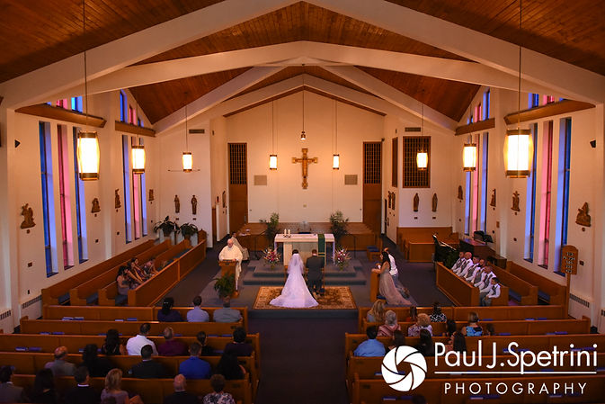 Samantha and Dale listen to their priest during their October 2017 wedding ceremony at St. Robert's Church in Johnston, Rhode Island.