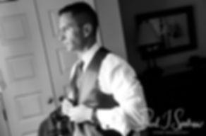 Kurt fixes his vest prior to his November 2018 wedding ceremony at the Publick House Historic Inn in Sturbridge, Massachusetts.
