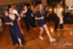 Guests dance during Mike & Kate's May 2018 wedding reception at Regatta Place in Newport, Rhode Island.