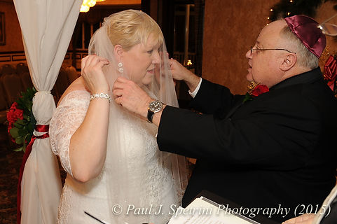 Cathy has her veil put up during her and Ron's December 2015 wedding at Quidnessett Country Club in North Kingstown, Rhode Island.