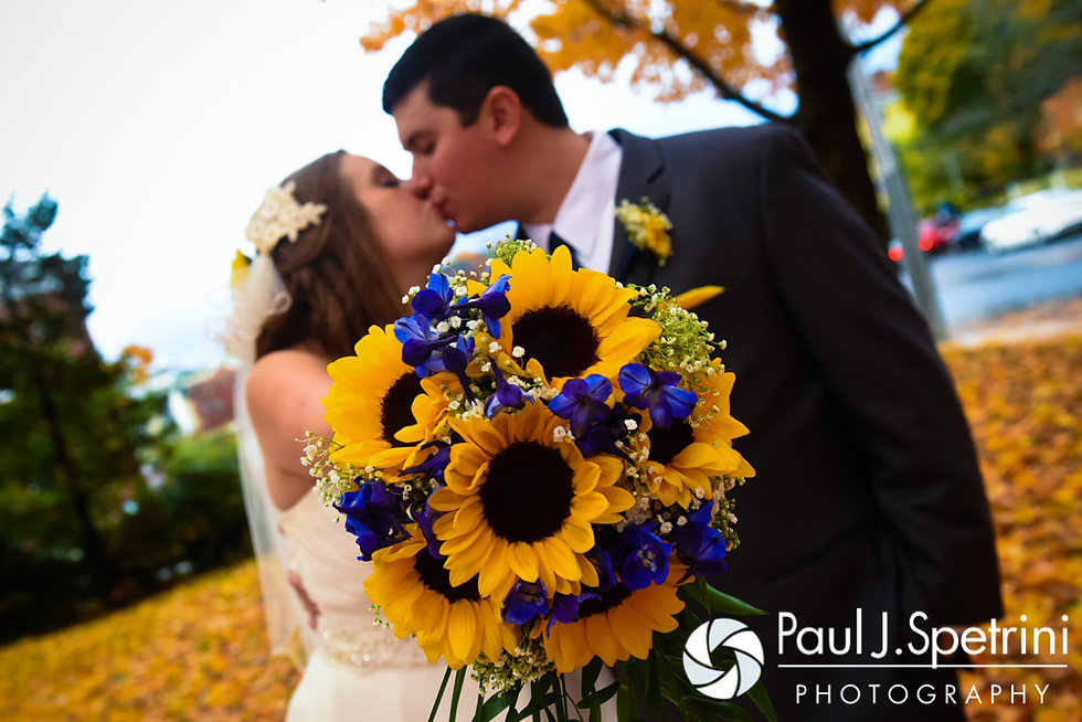 Kristin and Chris kiss during a formal photo prior to their October 2016 wedding reception at the Ashworth by the Sea Hotel in Hampton, New Hampshire.